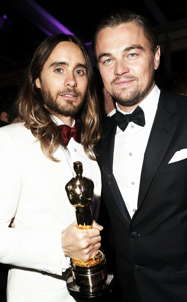 Jared Leto & Leonardo DiCaprio   Just look at the pain in Leo's eyes... I feel like he's about to grab oscar and run.