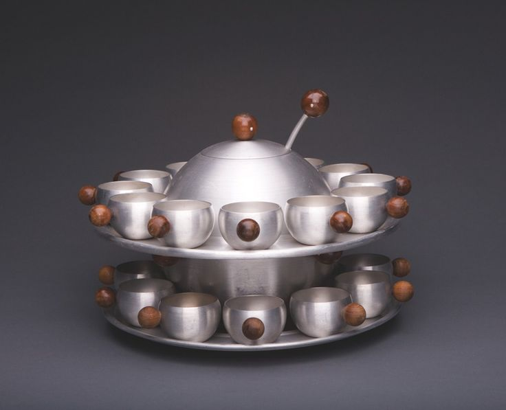 designer: Russel Wright Punch Bowl: Saturn c. 1935by Wright Accessories/Raymor