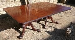 """Early 19th century Regency mahogany twin pedestal dining table. This table is a very impressive scale which might not be immediately apparent from the photographs. The top is made of large sections of very finely figured mahogany with reeding around the double edged top, typical of Irish furniture made by Williams, Mack and Gibton of Dublin. The pedestals are strong yet restrained in design.   Irish circa 1825 £14,500  93"""" long 29"""" high 57"""" wide"""