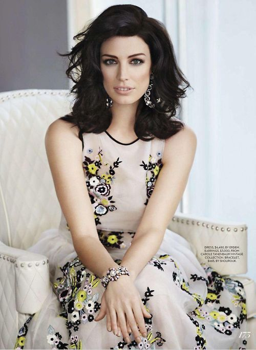 Hair!  Jessica Paré (born December 5, 1980)[1] is a Canadian film and television actress and singer. She has appeared in the films Stardom (2000), Lost and Delirious (2001), Wicker Park (2004), Hot Tub Time Machine (2010), and co-starred in the vampire horror-comedy Suck (2009). She stars as Megan Draper on the AMC television series Mad Men.