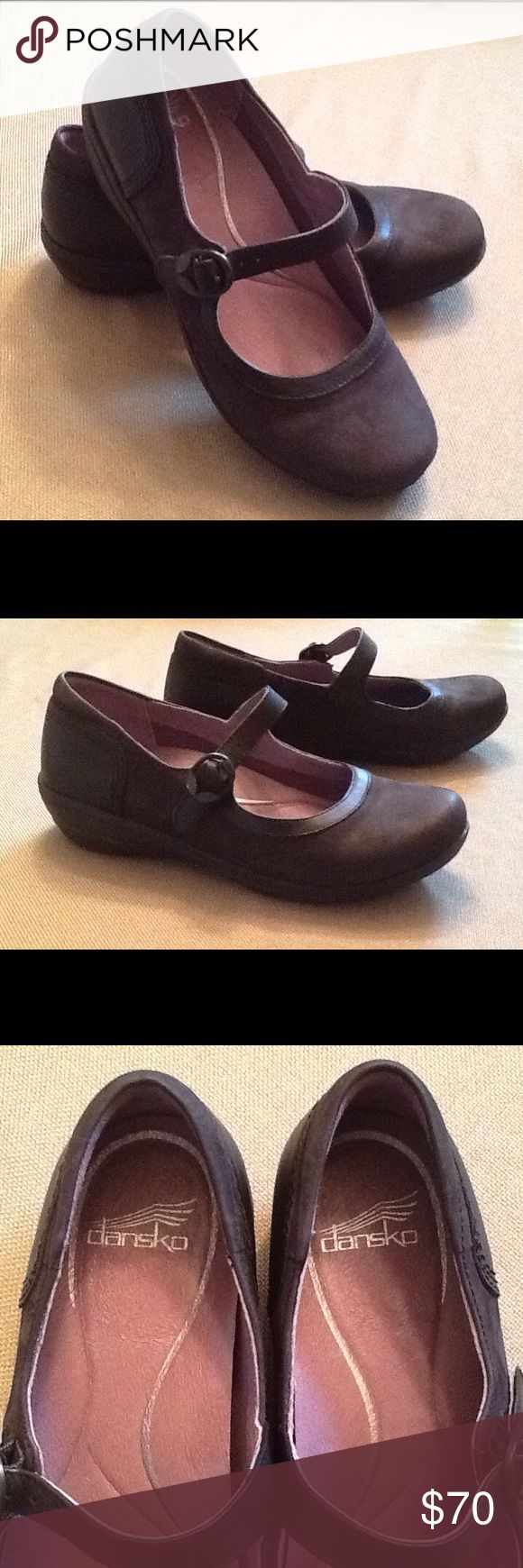NWOT Dansko Mary Janes Super cute Black and Dark Gray Nubuck Leather Mary Jane.  Brand new, size 38.  This shoe has a removable, cushioned footbed with arch support.  Leather strap, 3M Scothgard  protection for stain resistance. Dansko Shoes Flats & Loafers