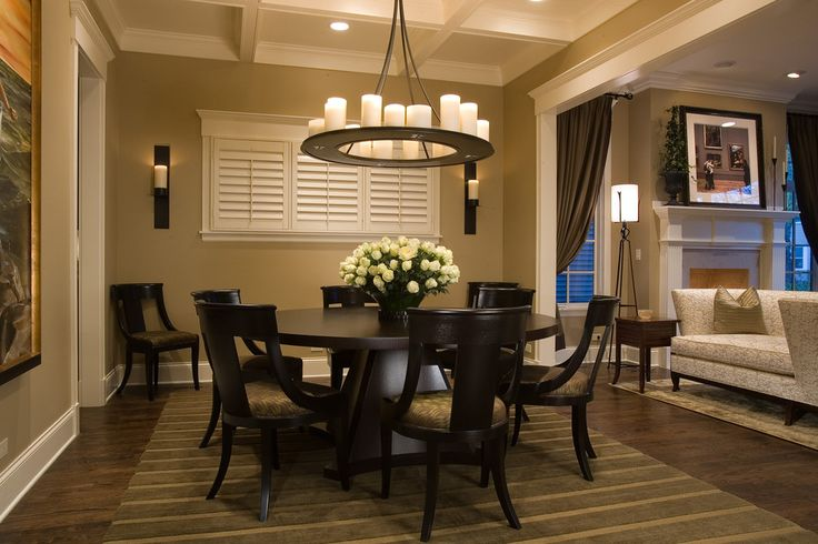 expandable round dining table Dining Room Traditional with area rug baseboards centerpiece chandelier coffered ceiling