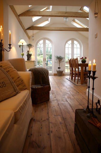 hardwood floors, beams, skylights, clean white, arched windows