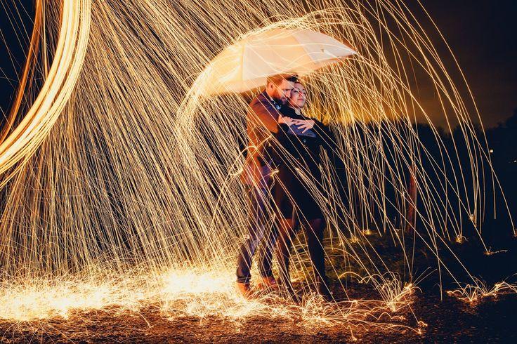 Magical effect: spinning steel wool and a lovely couple under an umbrella. They are on fire! Een magisch plaatje: een liefdeskoppel onder een paraplu en het vuur van brandend staalwol. Een thema van de gratis loveshoot. Made by me / Gemaakt door mij: www.fotozee.nl Ik ben graag jullie trouwfotograaf!  photography trouwfoto's trouwfotografie bruidsfotografie e-session prewedding session