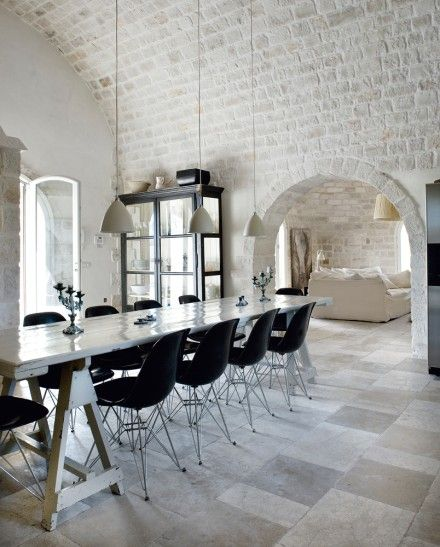 Love everything about this cool, white, serene space. The black Eames chairs at the trestle table make the white that much stronger.