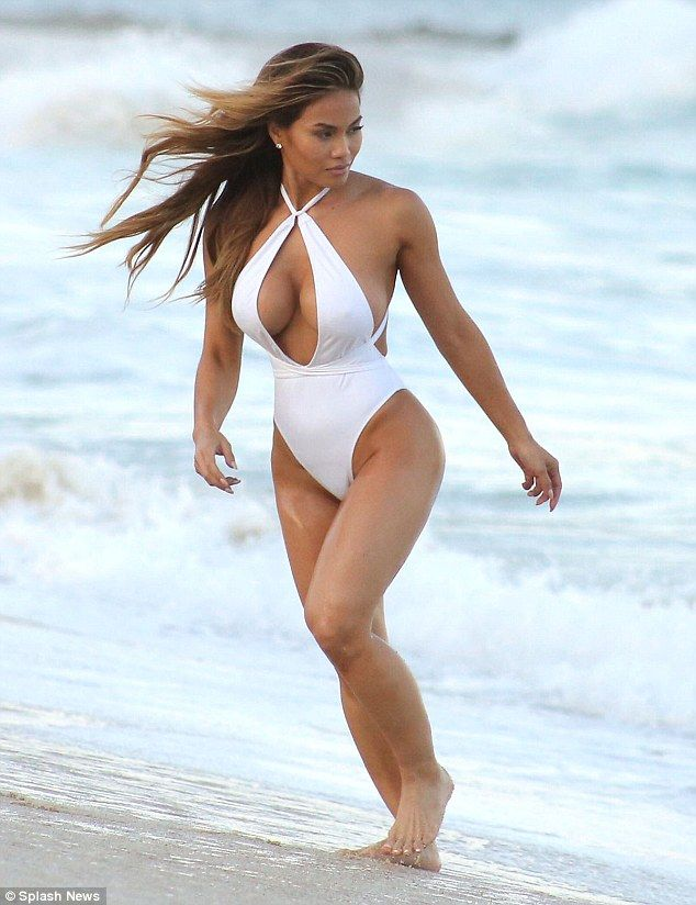 In the swim! Daphne Joy modeled a risque white one piece as she hit the shore of Cabo, Mexico on Friday