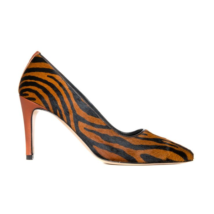 The Sid Furry zebra This is an Italian made all leather pump in zebra striped fur with a cognac leather back strap and leather clad heel. It's 8 cm heel height and all natural materials makes this all toghether a most comfortable pump that lets your feet breath and relax. The shoe gives little or no toe cleavage.