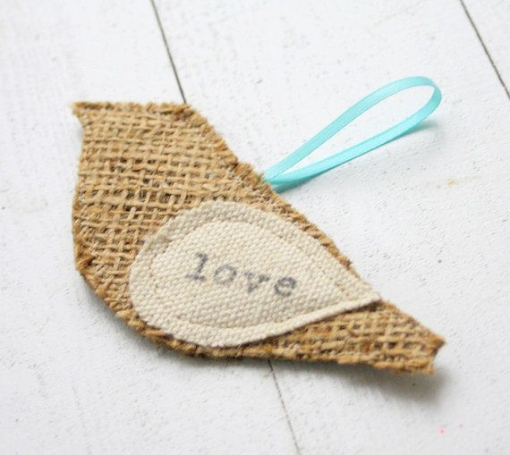 burlap ornament - I can't imagine how hard it is to sew burlap in real life though - tough on the needle and keeps unravelling...Perhaps pasting it to a piece of cardboard with some batting...