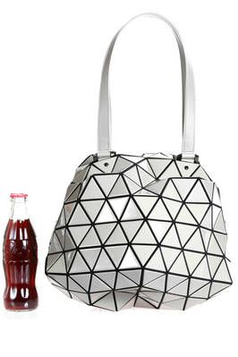 BAO BAO - Issey Miyake | spherical bag made of triangular polished PVC plates repeated through an origami calculation on a polyester base | #baobao