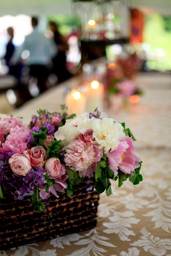 Basket of purple, pink and white garden flowers: peonies, roses, phlox and stocks