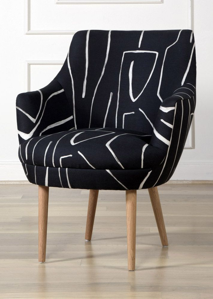 KELLY WEARSTLER | SONARA ARM CHAIR. Tapered oak legs and upholstered in Kelly's Graffito fabric