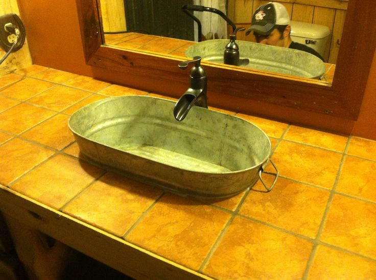 Our new rustic western bathroom sink & faucet.