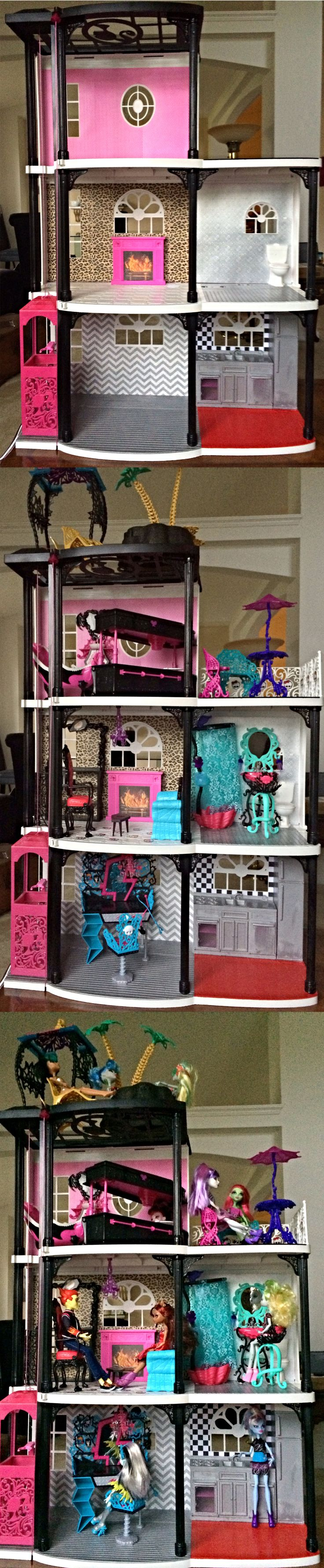 "My daughter's new Monster High House.  I found a used Barbie Dream Townhouse at a consignment store, repainted it and added some scrapbook ""wallpaper"".  We gave it to her for her birthday and she LOVES it!!!"