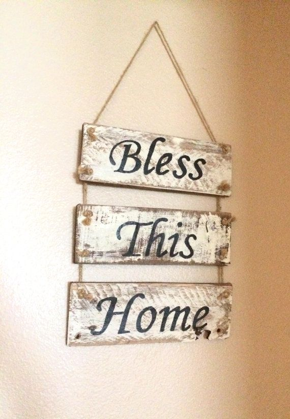 Bless This Home sign. Measures 14 1/2 x 9 1/2. Sign is stained and distressed to give it a rustic appeal. Jute string is intertwined between the boards and also attached for easy hanging. Perfect piece for your entryway or any room in your home. Can customize sign to make bigger or smaller.  Please take note that their might be a slight variation to the product that is made for you. Each piece of wood is unique and different; therefore, providing different variations in color, shape, grains…
