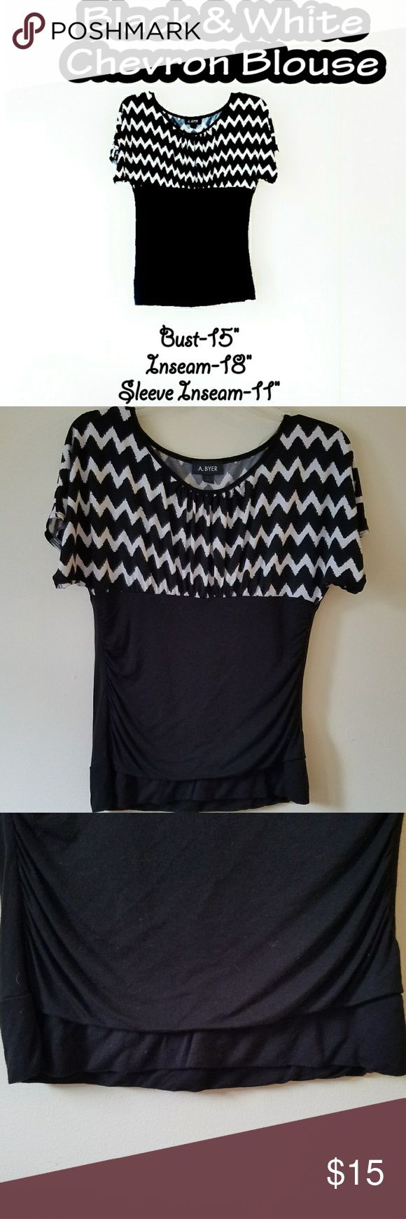Chevron Blouse Black & white chevron blouse. Worn twice and is in perfect condition. It does stretch, a little bit.        ✔Negotiations welcome (reasonable)✔ 🚫No trades🚫 🛒 💵Bundles ALWAYS get a private discount💵 ⛤I am a 5 star rated buyer⛤ 🚛I ship same day, next day at the lastest🚛 🚿All clothes get washed before packaging & shipment🚿 Tops Blouses