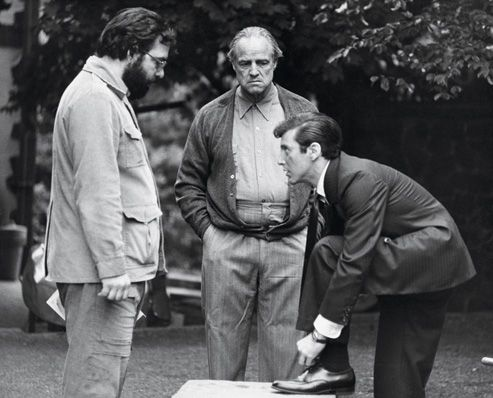 The director, the legend, and the star in the making on set of The Godfather.