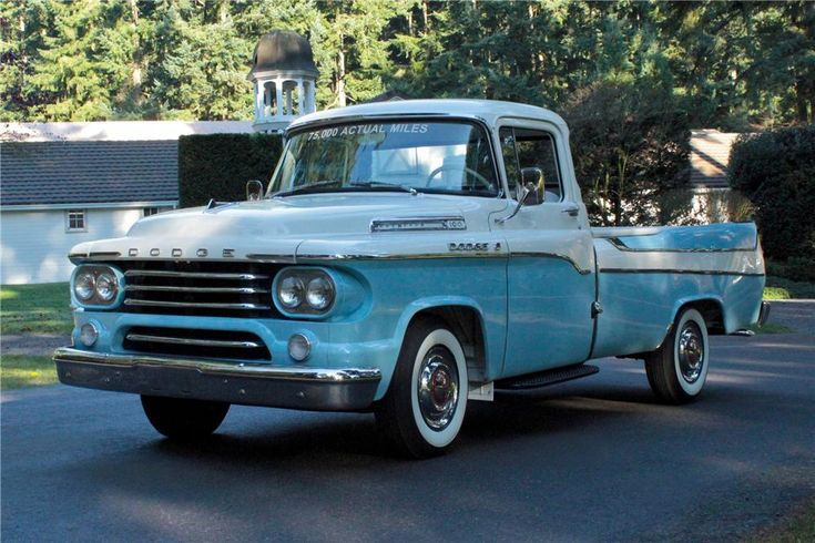 Front look of a 1958 Dodge Swept Side pick up.