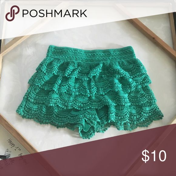 Teal Lace shorts Cute layered lace bright Teal shorts from the Juniors section. Fit Small-Medium women. Xhilaration Shorts