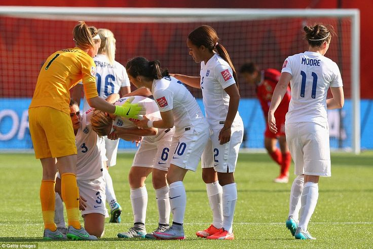 A crestfallen Laura Bassett is comforted by team-mates after her freak own goal ended England's World Cup in heartbreaking fashion