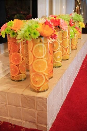 Summer centerpieces orange green yellow with fresh fruit Orlando wedding flowers…