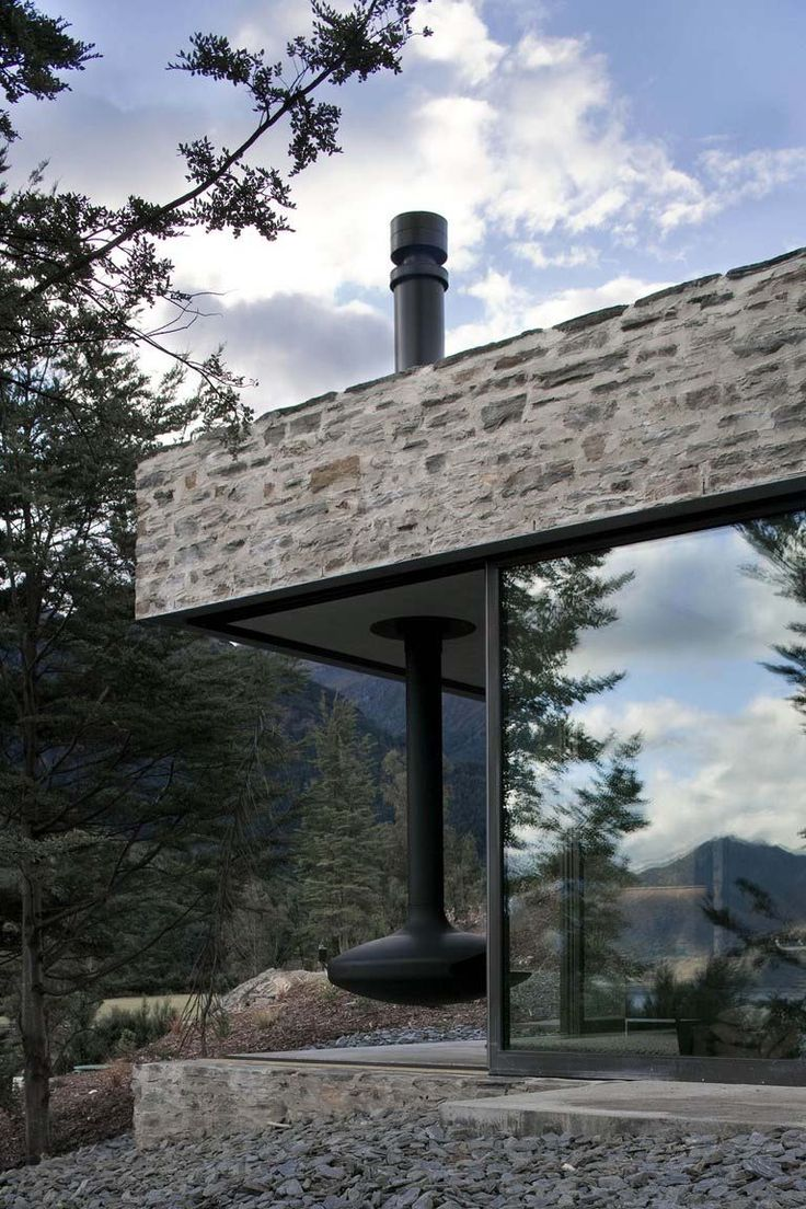 designed by Fearon Hay Architects, nestled high on a mountain next to Lake Wakatipu on the South Island of New Zealand.