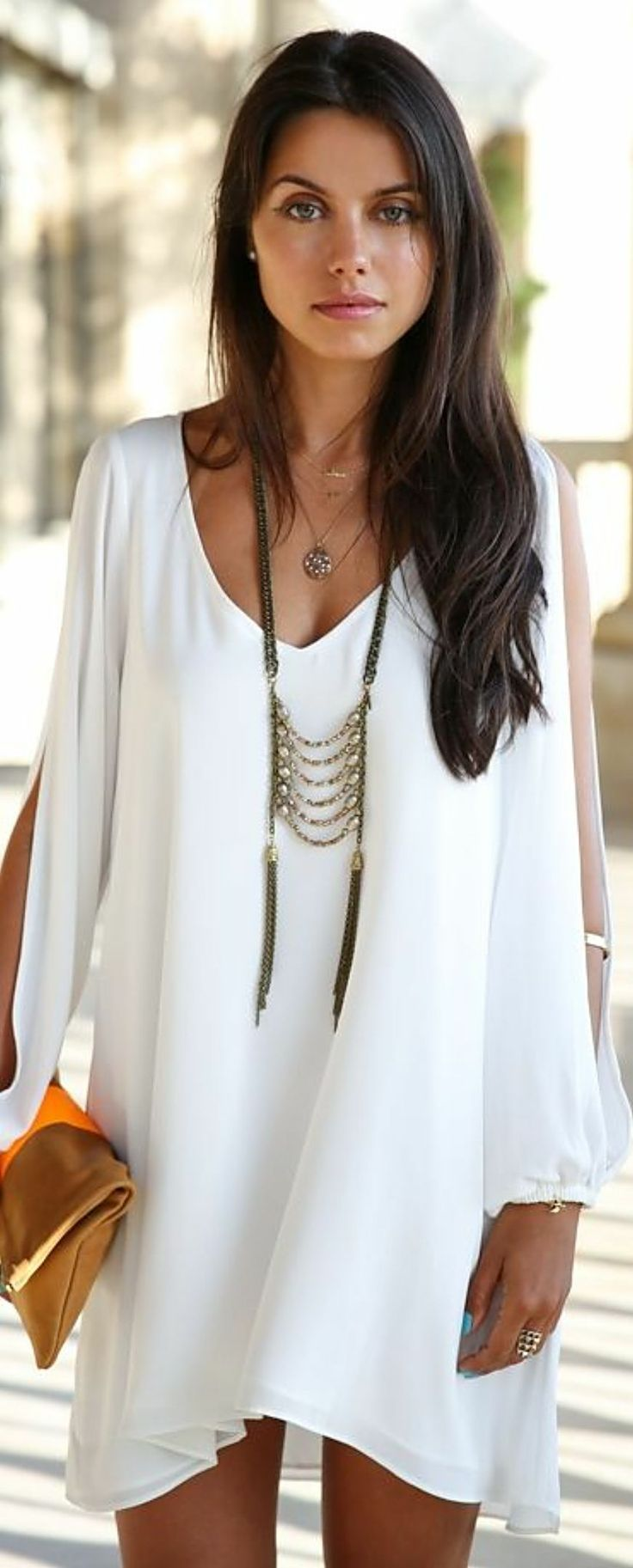 Not loving the open sleeves, but love the simplicity of the white shift dress with a long necklace and pair of sandals or flats. Great for work, date night and vacations. Always have problems with white dressed being see-through though.