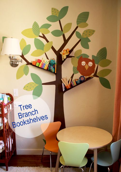 DIY tree branch bookshelves for baby / kids room: we have always loved this type of wall stickers as they are so easy to remove or update, but what a great way to take it a little futher by popping shelves on there too! Kristy ..this is cute