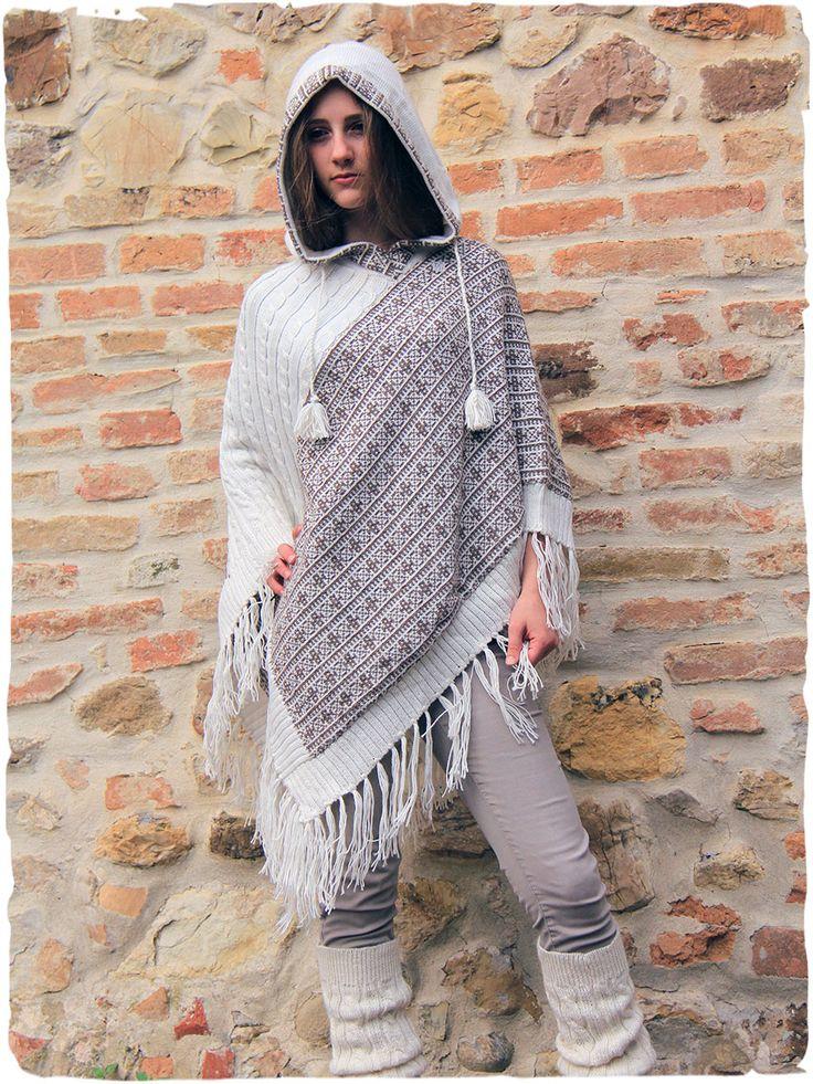 Poncho lana Zelda #Splendido #poncho in lana d' #alpaca con #cappuccio. #Frange sul fondo. I colori del disegno etnico, sapientemente abbinati, esprimono gentilmente il gusto raffinato tipicamente #italiano. Avvolgente e caldo questo #poncho #unisex non passa inosservato. www.lamamita.it/shop/abbigliamento-invernale/poncho-lana-zelda #alpacaponcho #poncho #womensponcho