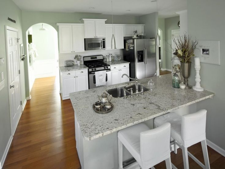This Kitchen Is Lightened Up By Painting The Dark Maple