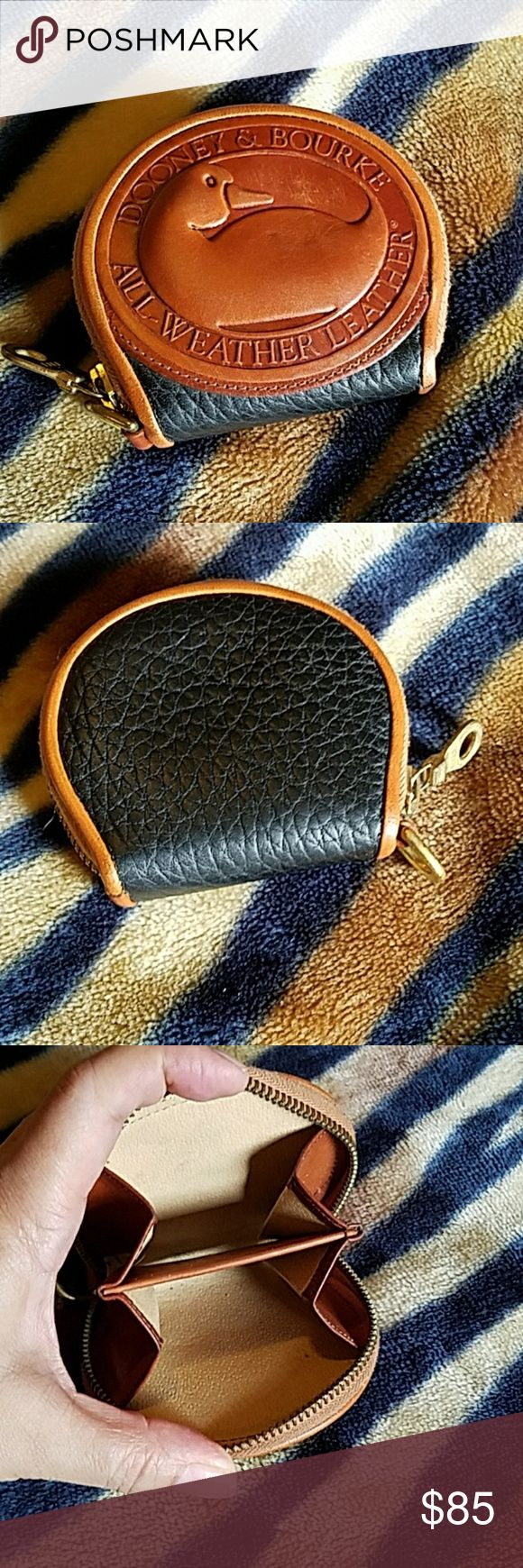 Dooney and Bourke Big Duck coin purse Dooney and Bourke Big Duck coin purse.  EUC.  Black all wether leather with British tan trim. Dooney & Bourke Bags Wallets
