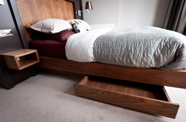 Built-in storage units under the floating bed help hide away the mess! - Decoist