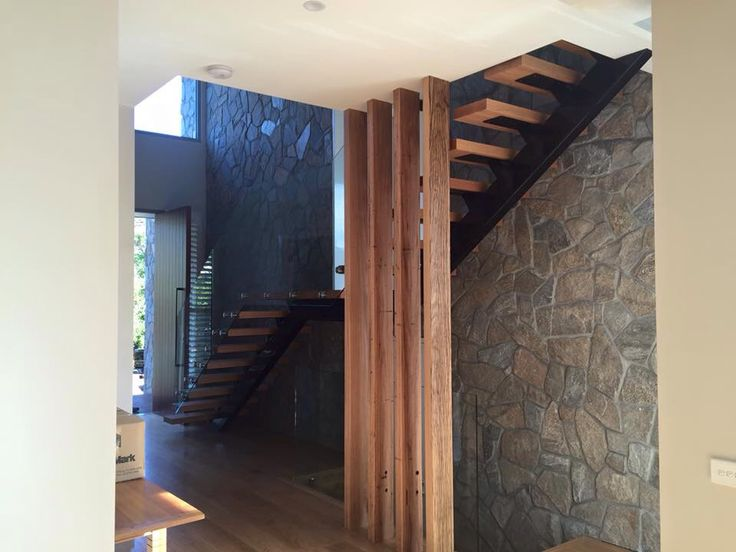 Timber feature posts and stone wall in foyer of Sorrento home built by Jigsaw Projects. www.jigsawprojects.com.au