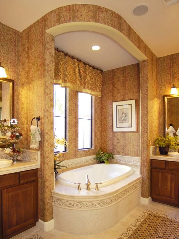 A Master Bath Bay With An Arched Soffit Encloses The Tub
