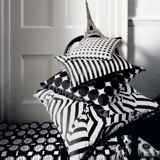 Parisian-style geometric cushions | Art Deco | Parisian-style geometric cushions ... Art Deco style was born in Paris in the 1920s and has been influencing glamorous and eclectic interiors ever since.    These ultra-stylish cushions evoke the linear symmetry associated with the era and are guaranteed to add a touch of period drama to your living room.