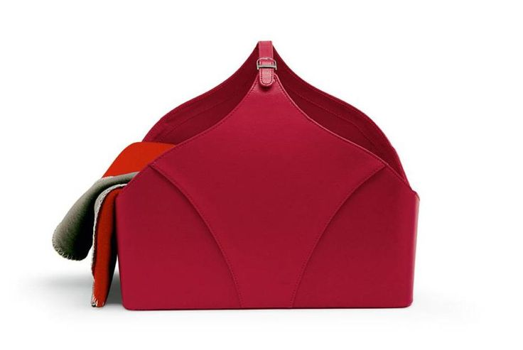With its handy carrying handle and metal details, this useful container resembles a roomy bag. $170
