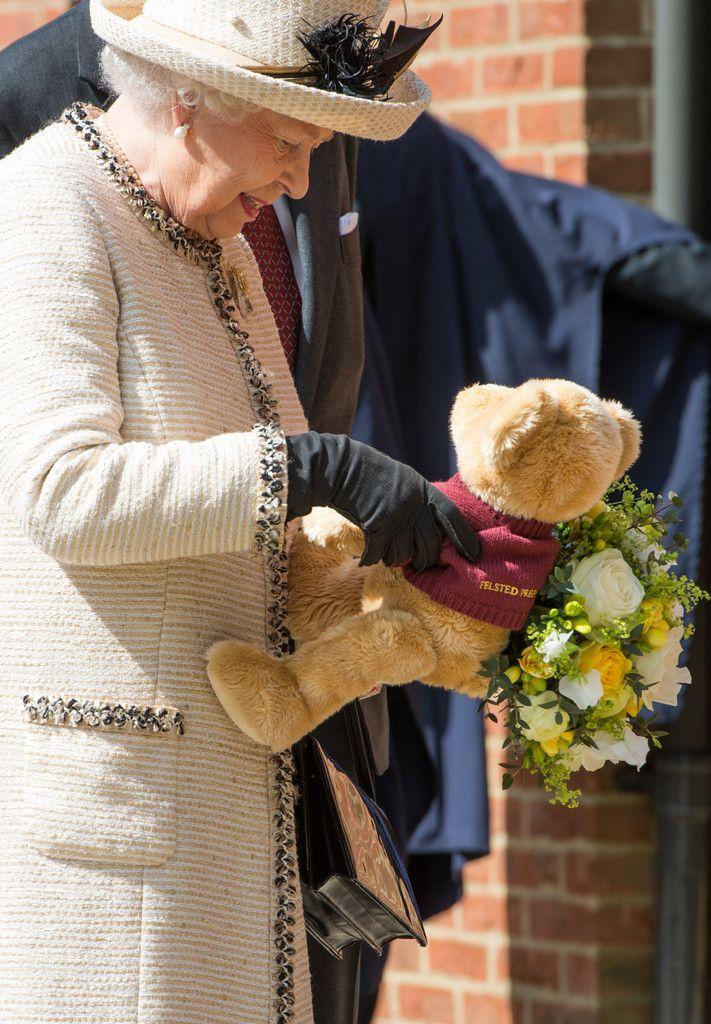 5/6/2014: Queen Elizabeth II receives a teddy bear & flowers as she arrives at Felsted School (Felsted, Essex)