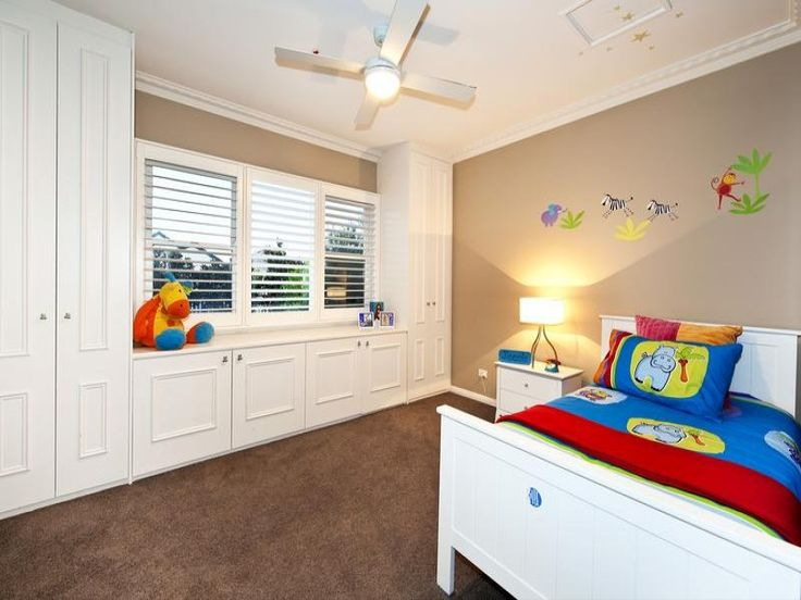 Photo of a children's room bedroom design idea with carpet & built-in shelving using blue colours - from the bedroom ideas galleries - Bedroom photo 162651. Browse hundreds of images of children's room bedrooms & photos of built-in shelving in bedroom designs.