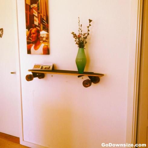 Hang your bike and skateboards on your wall | http://www.godownsize.com/skateboard-snowboard-bike-wall/