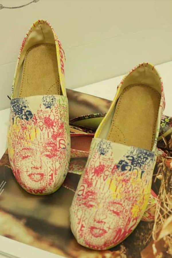 the shoes has been crafted in canvas, featuring a round toe, low-cut vamp, marilyn monroe print to the front, leather insole, flexible outsole, in a slip on style.