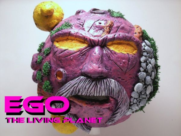 this is a marvel legends Ego the Living Planet Custom Action Figure he was made by figure realmer goliath customs he used a 8 inch Styrofoam ball, he wrapped it with aluminum foil then covered completely with apoxie and a paper towel to get the texture down, the stand was a kitchen funnel, and the mini planets were ping pong balls with apoxie happy pinning