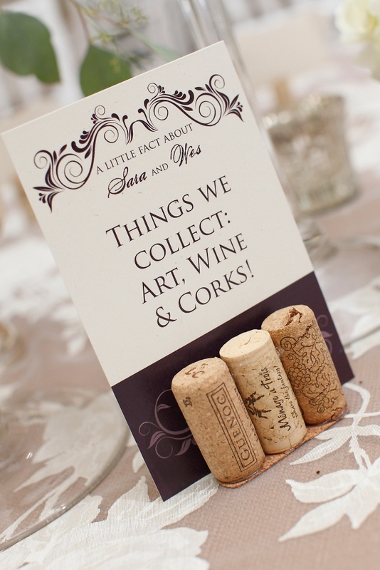 Purple and white wedding signs; wine cork place card holders  www.significanteventsoftexas.com