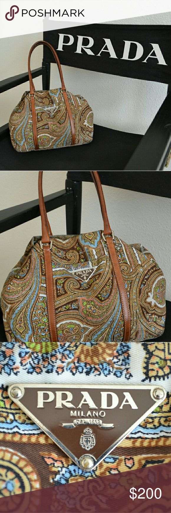 PRADA Tessuto Nylon Tote Paisley Fall Paisley Medium sized Prada Tessuto nylon tote. Rare fall paisley pattern with brown leather accents. Brown & Silver Prada insignia on front, Creme & Silver Prada insignia inside. Brown leather handles, unique Prada Silver Clasp, and silver colored studs on base of bag. Interior color is creme, with a single zipper pocket. 100% Authentic, purchased in Rome. This is a GENTLY USED item in Good Condition. A few pen marks on inside lining and other minor…