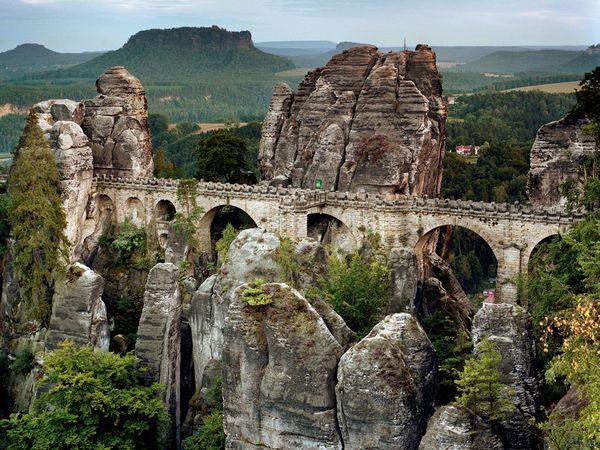 Bastei Bridge rises above the Elbe River in Germany's Saxon Switzerland National Park.