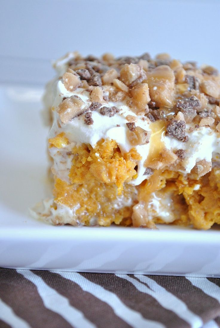 Pumpkin Cake~ soaked in sweetened condensed milk, smothered in cool whip, caramel, and heath bits on top!