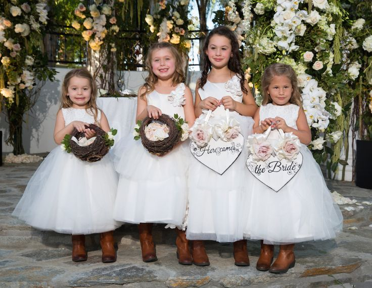 The flower girls wore tulle dresses and cowboy boots. Photography: Jay Lawrence Goldman Photography. Read More: http://www.insideweddings.com/weddings/rustic-vintage-outdoor-ceremony-tent-reception-in-palm-springs/692/