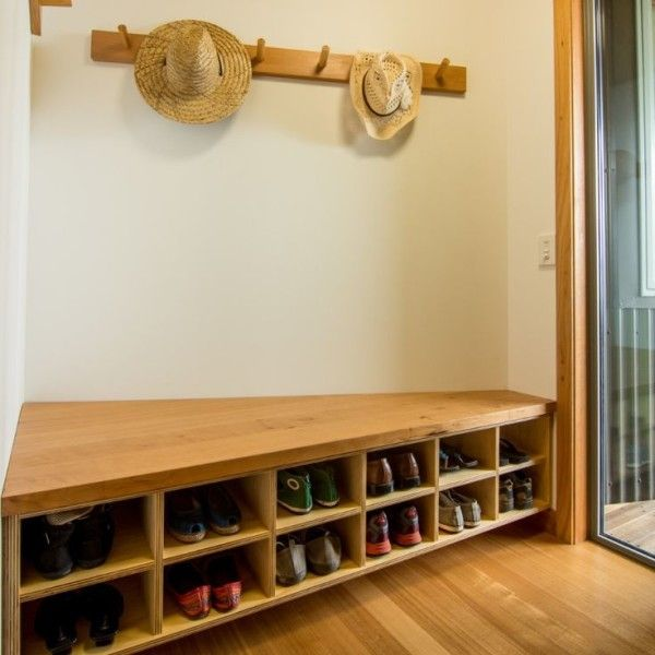 hallway coat storage furniture nearby decorative cowboy hats above corner shoe rack bench from pressure treated