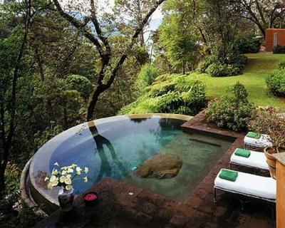 infinity pool hot tub spa in a garden