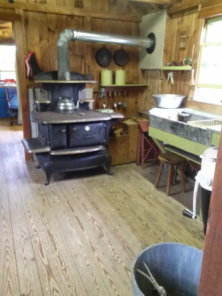 Photo taken 2014: Kitchen in the Nickerson North Beach Camp showing the dry sink and pump, and the wood burning stove that could heat the entire camp. #nickerson, #northbeachcamp, #northbeach, #camp, #beachcamp, #atwoodhouse, #chathamhistoricalsociety, #chatham, #capecod