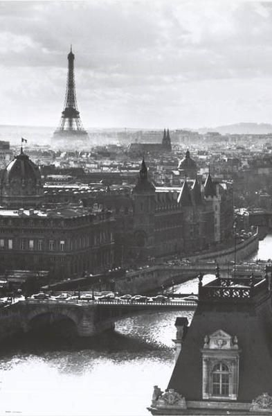 Paris, France - overlooking the Seine River with the iconic Eiffel Tower in the distance!