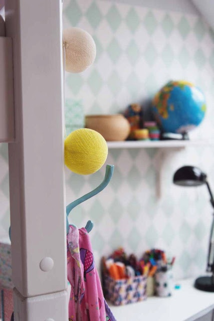 kids room with harlekin wallpaper and fairy lights from la case de coussin paul